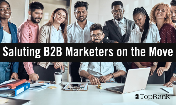 Group of B2B marketers around table image.